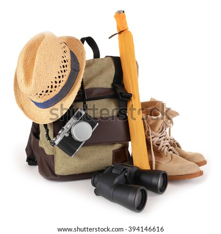 Tourism concept. Backpack, shoes, binocular and camera isolated on white background - stock photo