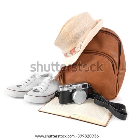 Tourism concept. Backpack, shoes, hat and camera isolated on white background - stock photo
