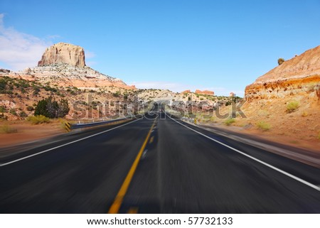Tourism on high speed. The American highway in state of Utah, sunrise - stock photo