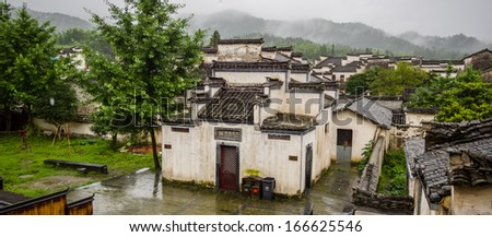 Tourism toilets in rains, very cool, right?  Xidi is an ancient village near Huangshan, World Heritage Site by UNESCO, has many wonderful traditional Chinese architectures and carvings - stock photo