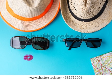 Tourism - Tourist - Tourists concept - Ready for the road - Road trip - Travel - Traveling together - Summer holiday - He and she - Tourism concept - Blue background - Map sunglasses hat - Vacation - stock photo