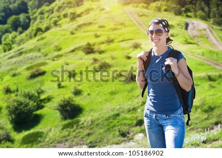 tourism. young girl woman hiking in the mountains - stock photo