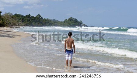 Tourist at famous Caribbean beach - stock photo