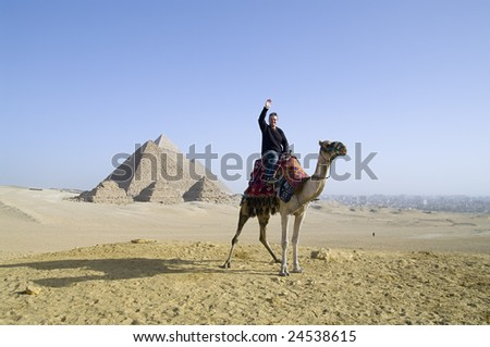 Tourist at the Pyramides - stock photo