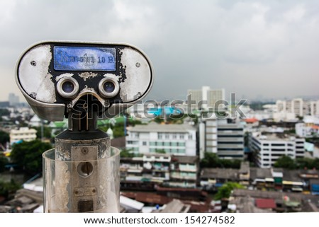 tourist binoculars at high point view - stock photo