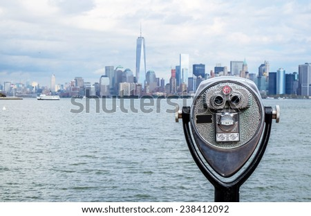 tourist binoculars at Liberty Island - stock photo