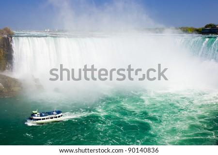 tourist boat cruise pass Niagara Falls - stock photo