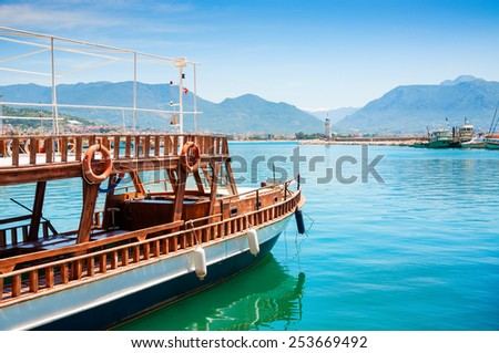 Tourist boat in the port of Alanya, Turkey. Beautiful views of sea and mountains - stock photo