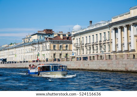 Tourist boat on the river Neva in St. Petersburg in Russia