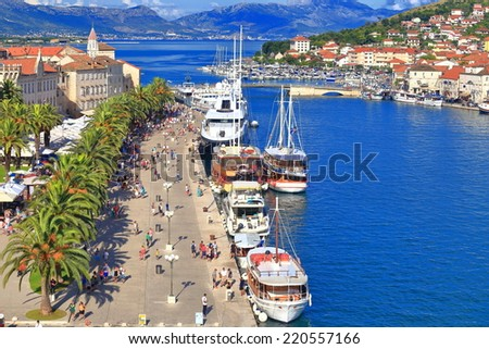 Tourist boats anchored on a pier of Venetian old town near the Adriatic sea, Trogir, Croatia - stock photo