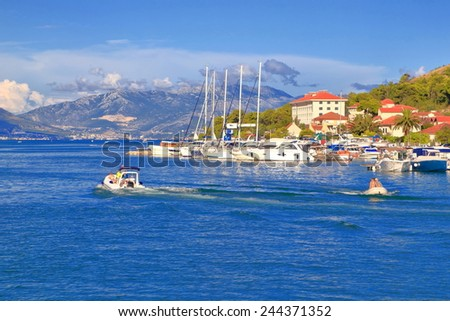 Tourist boats near old Venetian town by the Adriatic sea, Trogir, Croatia - stock photo
