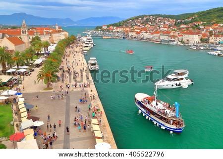 Tourist boats near the pier on the Adriatic sea, Trogir, Croatia - stock photo