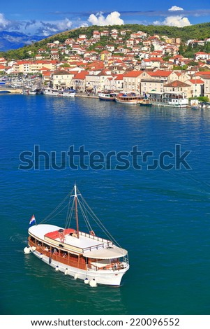Tourist boats on a canal inside Venetian old town near the Adriatic sea, Trogir, Croatia - stock photo
