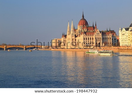Tourist boats on Danube river visiting the Parliament building, Budapest, Hungary