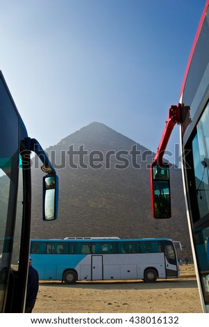 Tourist buses parked in front of Giza pyramids in Cairo, Egypt - stock photo