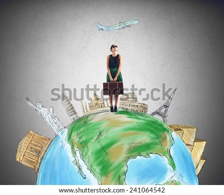 Tourist chooses her destination for next trip - stock photo