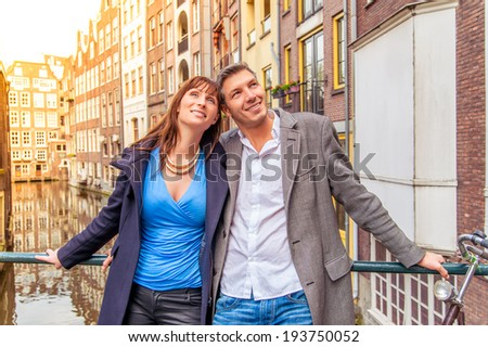 tourist couple exploring new city - stock photo