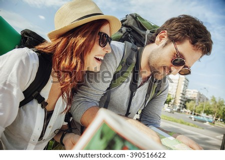 Tourist Couple In The City Browsing Map