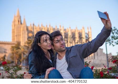 TOURIST COUPLE ON VACATIONS MALLORCA SPAIN - stock photo