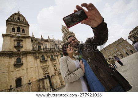 tourist couple taking selfie at jaen cathedral in europe travel.
