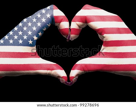 Tourist gesture made by america flag colored hands showing symbol of heart and love - stock photo