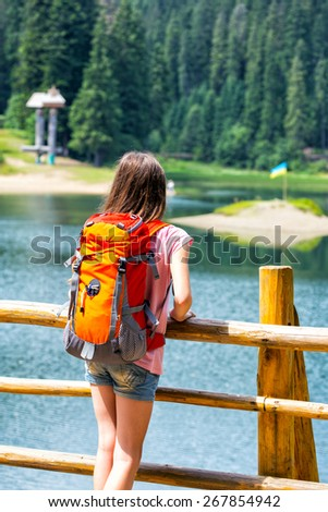 tourist girl at the  lake Synevyr and mountain views, Ukraine - stock photo