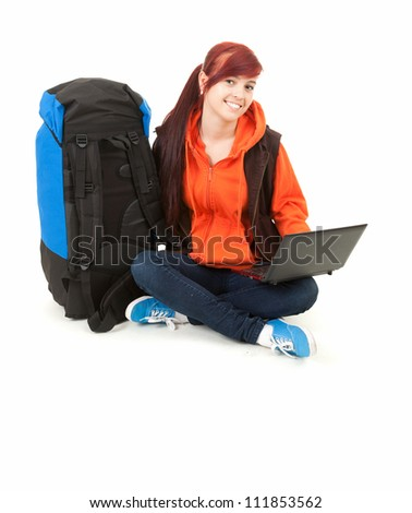 tourist girl with backpack and laptop, full length, white background - stock photo