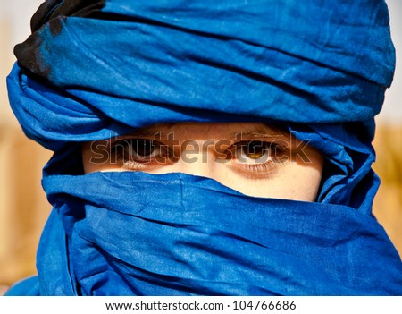 Tourist girl with typical nomad head cover - blue turban - stock photo