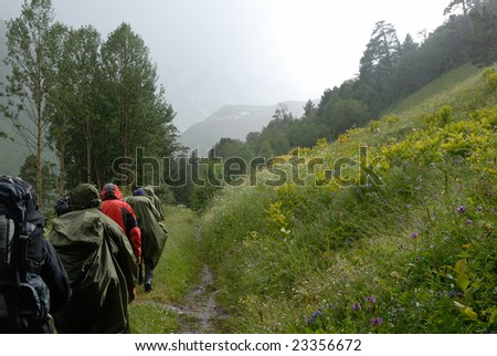 tourist group in rainy highland valley