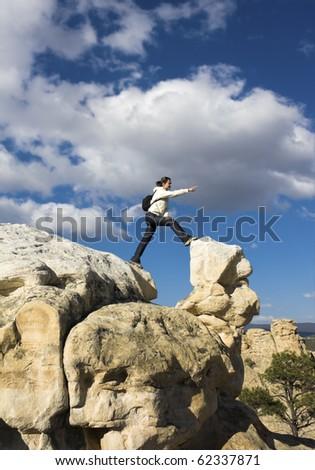 Tourist in El Morro National Monument, New Mexico. - stock photo