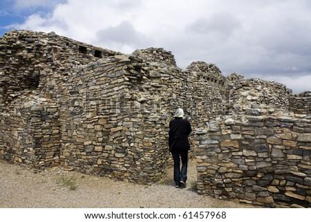 Tourist in Gran Quivira Ruins in New Mexico, USA. - stock photo