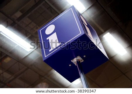 tourist information sign in a station with neon lights in background - stock photo
