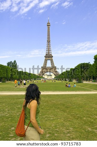 Tourist looking at the Eiffel Tower - stock photo