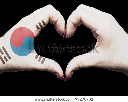 Tourist made gesture  by south korea flag colored hands showing symbol of heart and love - stock photo