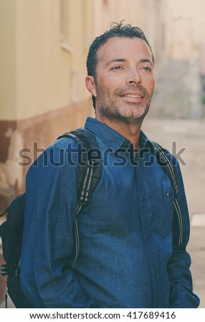 Tourist man standing in the city center during his trip in italy, selective focus