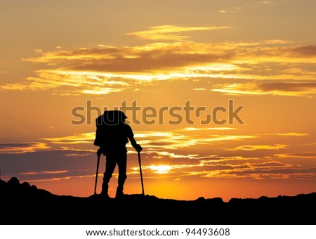 Tourist on background bright sky. Bright sunshine and silhouettes - stock photo