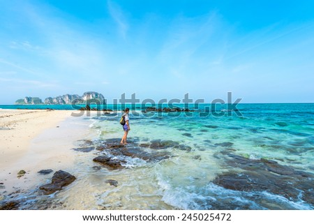Tourist on the beach in Thailand, Asia. Bamboo Island in Thailand- blue sky and with silky soft white sand, and exceptionally clear water - stock photo