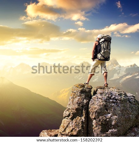 Tourist on the mountain top. Sport and active life concept - stock photo