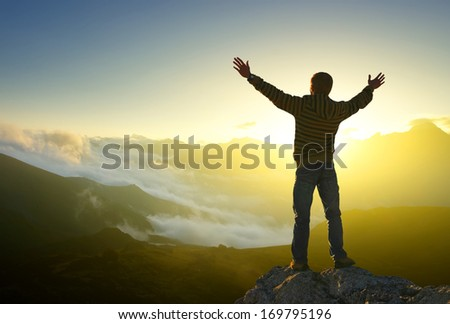 Tourist on the sunset background. Sport and active life concept - stock photo