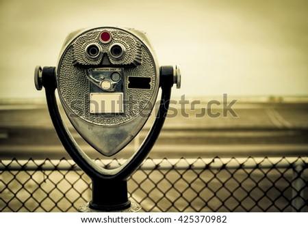 tourist retro coin operated binoculars on the beach in New York City - stock photo