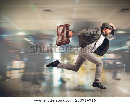 Tourist runs late to the flight departure - stock photo