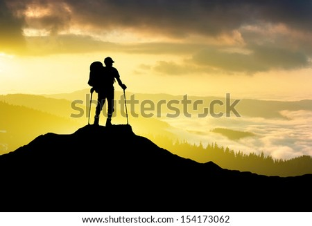 Tourist silhouette on the sun glow background. Sport and active life concept - stock photo