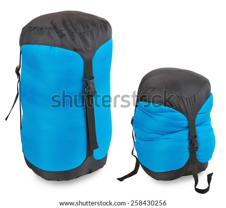 Tourist sleeping bag in a compression bag on a white background - stock photo