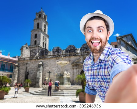 Tourist taking a selfie photo in Havana, Cuba (San Francisco Square) - stock photo