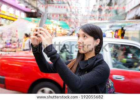 Tourist taking photo in Hong Kong - stock photo