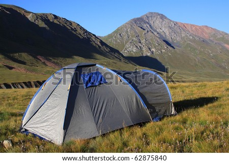 Tourist tent in a mountain landscape - stock photo