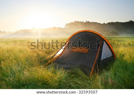 tourist tent  in the sunrise - stock photo
