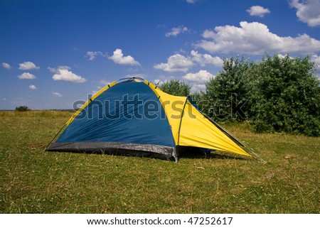 tourist tent on nature on a background clouds