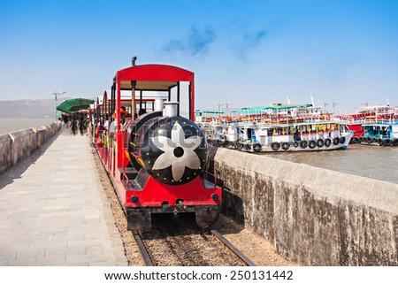 Tourist train to the Elephanta caves on Elephanta Island, India - stock photo
