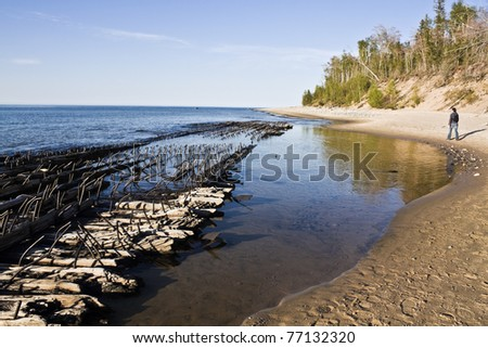 Tourist walking on the beach - Pictured Rocks National Lakeshore. - stock photo
